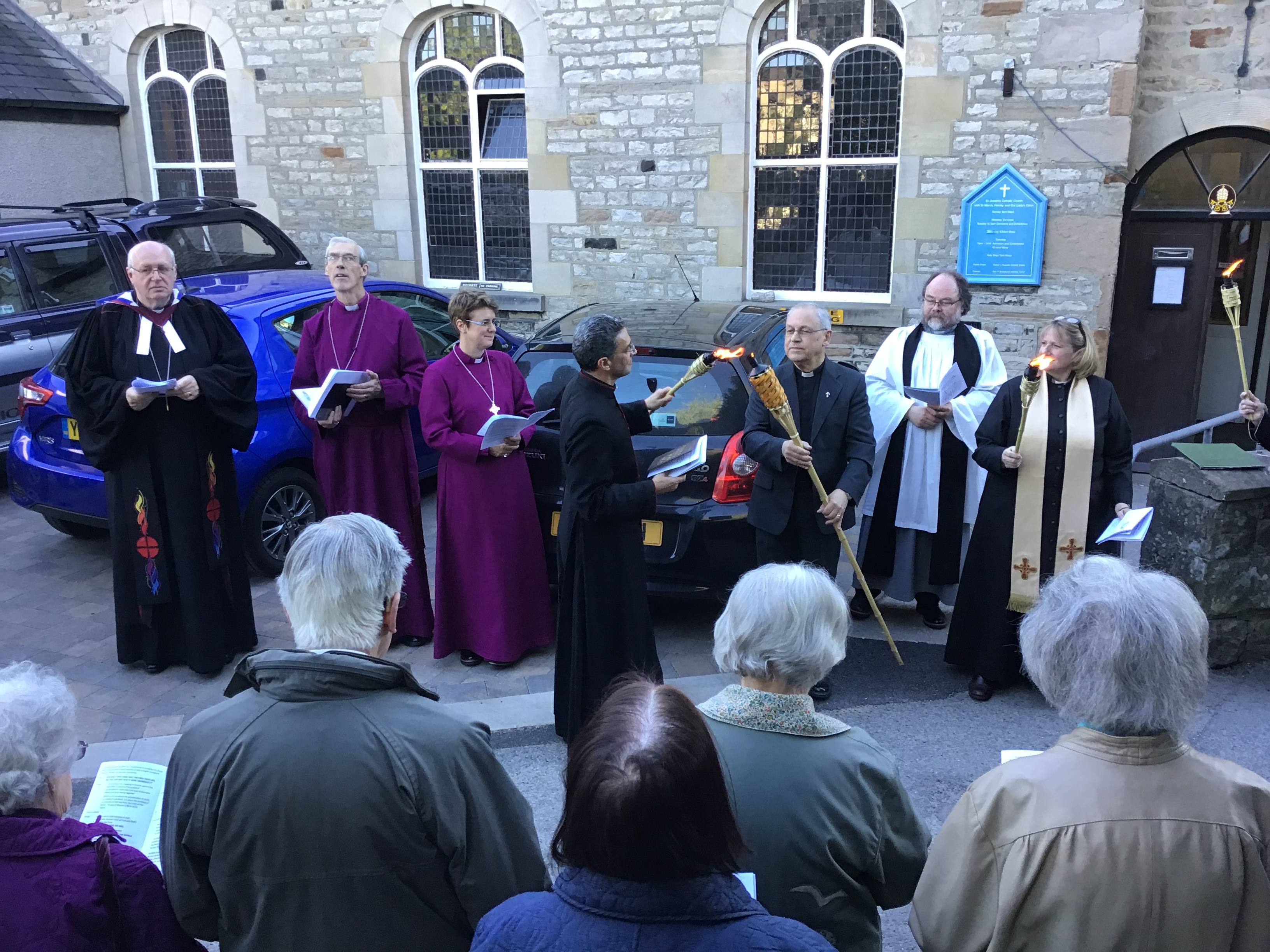 Lighting the beacon carried around churches in Kirkby Lonsdale